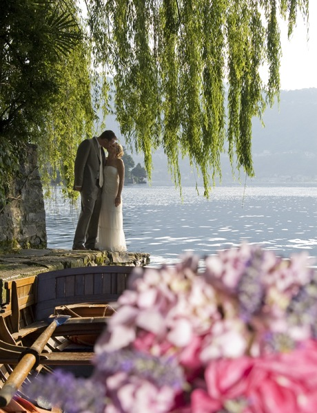 Married couple at destination wedding location Lake Orta